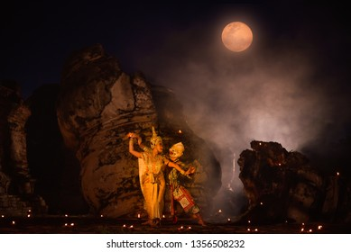 Khon is art culture Thailand Dancing in masked  Hanuman and Suvannamaccha are lovers showing in literature Ramayana.Khon is thailand culture and traditional with dark night sky background.