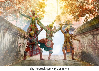 Khon is art culture Thailand Dancing in masked Ramakien ,Hanuman and tos-sa-kan are Dancing in literature Ramayana.Khon is thailand culture and traditional sunlight background.