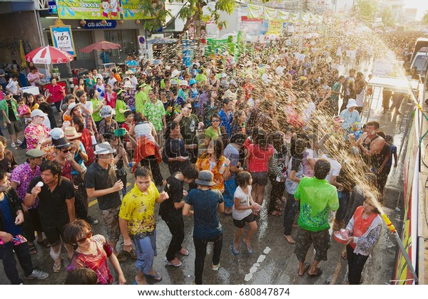 KHON KAEN, THAILAND - APRIL 13, 2010: Unidentified young people celebrate traditional Songkran festival at the street.