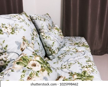 Khon kaen, Thailand, February 16, 2018 Vintage sofa flower wale with pillows and Curtain background.