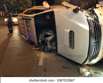 KHON KAEN, THAILAND- May 7, 2018: Car accident on city street with rescue officer manage traffic after crash.