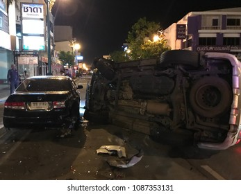 KHON KAEN, THAILAND- May 7, 2018: Car accident on city street with policeman manage traffic after crash.