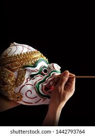 Khon mask making. Hanuman mask on black background. (Not an art that is copyrighted)