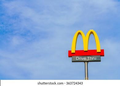Khonkaen Province, Thailand - December 20, 2015 : McDonalds logo on blue sky McDonald's Corporation is the world's largest chain of hamburger fast food restaurants.