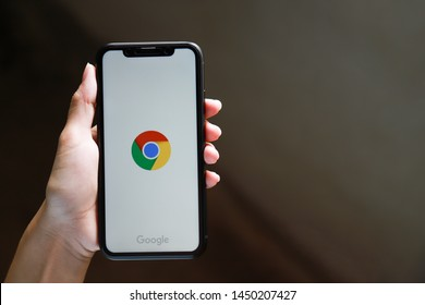 Khonkaen, Thailand - July 14, 2019 : Hand holding I phone XR with Gogle crome application on screen runing - illustrative editorial