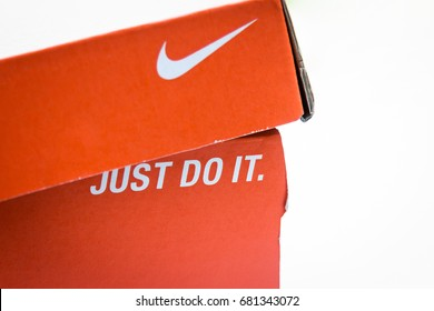 "Khonkaen, Thailand - July 21, 2017 :  Nike wording ""just do it"" on orange box paper - illustrative editorial"