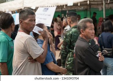 Khonkaen, Thailand - March 17, 2019: Old man with queue number ticket in hand stands in row for Pre-election at KhonKaen Sport Stadium, After the military dictatorship seized power for 5 years