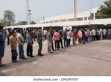 Khonkaen, Thailand - March 17, 2019: Young soldier stands in row with civilians for Pre-election at KhonKaen Sport Stadium, After the military dictatorship seized power for 5 years