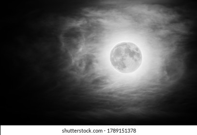 Khonsu is the ancient Egyptian god of the Moon, painted by the clouds in full moon night.
