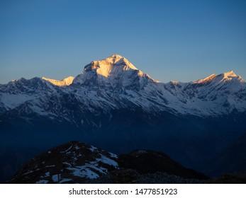 Khopra Danda, Nepal - circa April 2019: sunrise over Mount Dhaulagiri from Khopra Ridge