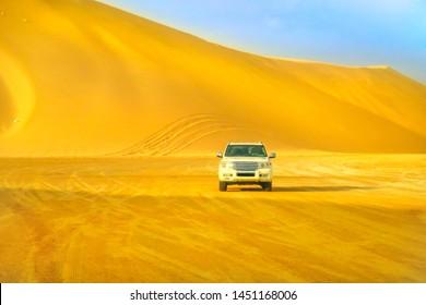 Khor al Udaid, Qatar - February 19, 2019: Off-road adventure in Arabian Desert. Front view of Toyota Land Cruiser 4x4wd after dunes bashing in inland sea near Saudi Arabian, Persian Gulf, Middle East.