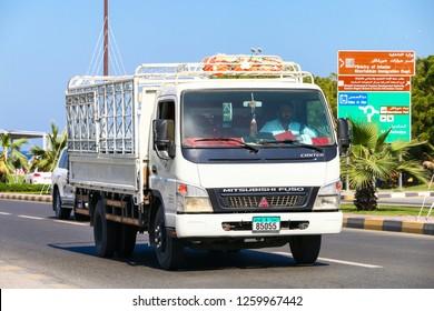 Khor Fakkan, UAE - November 18, 2018: Flatbed truck Mitsubishi Fuso Canter in the city street.