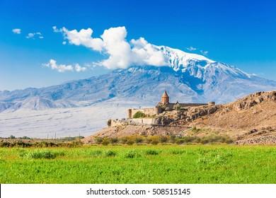 Khor Virap with Mount Ararat in background. The Khor Virap is an Armenian monastery located in the Ararat plain in Armenia, near the border with Turkey.