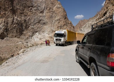 Khorog, Tajikistan August 24 2018: Offroad car and truck on the Pamir Highway in a canyon in the Wakhan valley in Tajikistan (Afghanistan on the left side)