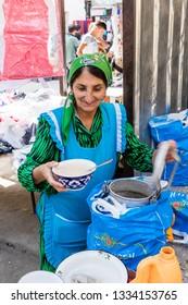 Khorog, Tajikistan August 25 2018: Old woman in the market in Khorog selling soup, Tajikistan