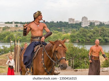 KHORTYTSIA, UKRAINE - JULY 03, 2018: Ukrainian Cossack horseman with saber in Zaporozhian Sich. It was inhabited by Cossacks who lived beyond the rapids of the Dnieper River in the 15th-18th century.