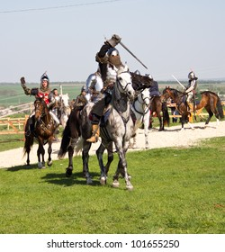 KHOTYN - APRIL 30: Group of � knights in armor fighting �with swords on �horseback - Medieval Khotyn Festival. April 30, 2012. Ukraine