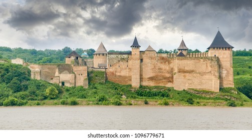 Khotyn fortress built in the 14th century on the right bank of Dniester river. Panorama of the fortress from the opposite bank on background of the sky with storm clouds, Ukraine