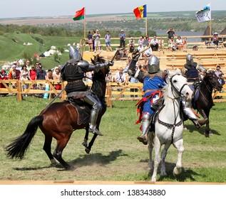 KHOTYN - MAY 10: Knights on�horseback  fighting during Festival Medieval Khotyn on May 10, 2013, Ukraine