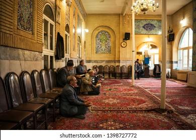 Khoy/Iran-April 23, 2019: Shia muslims are praying in  The colorful mosque at  Khoy, iran