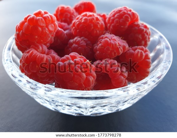 khrustal'noy chashe.  Ripe, red raspberries in a crystal bowl.
