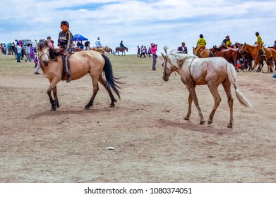 Khui Doloon Khudag, Mongolia - July 12, 2010: Young horsemen at Nadaam horse race on steppe outside Ulaanbaatar. Nadaam is Mongolia's most important festival whose roots lie in warrior traditions