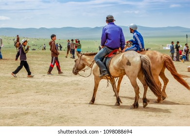 Khui Doloon Khudag, Mongolia - July 12, 2010: Horseback riders at Nadaam (Mongolia's most important festival whose roots lie in Mongolian warrior traditions) horse race near capital Ulaanbaatar.