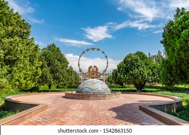 KHUJAND, TAJIKISTAN - MAY 2019: Arbob Cultural Palace Picturesque Breathtaking View of a Tajikistan Coat of Arms Sculpture on a Sunny Blue Sky Day