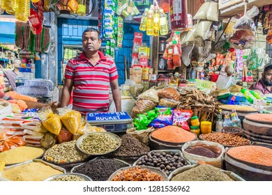 KHULNA, BANGLADESH - NOVEMBER 12, 2016: Local seller at a market in Khulna, Bangladesh