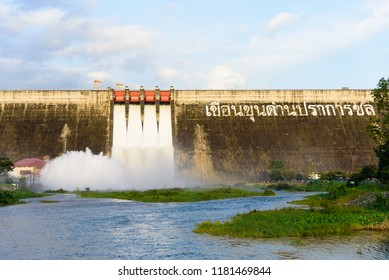 Khun Dan Prakarn Chon Dam has opening the gate for flowing the water in the morning with blue sky backgorund.