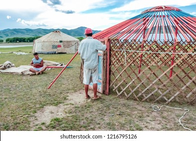 Khutag Ondor, Central Mongolia - July 17, 2010: Nomads construct traditional yurts called gers on central Mongolian steppe near Khutag Ondor village