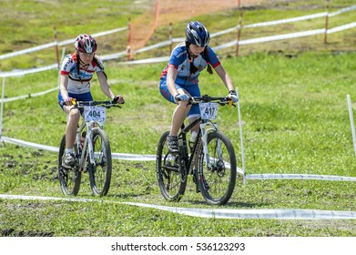 KHVALYNSK - MAY 7, 2016: Two female cyclist ride uphill at XCE eliminator track public open championship 'Match of Russian cities' on May 7, 2016 in Khvalynsk, Saratov region, Russia.