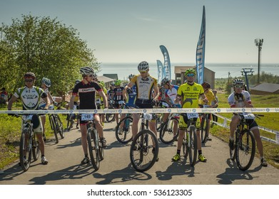 KHVALYNSK - MAY 9, 2016: Group of cyclists near the finish line at XCM highland marathon track public open championship 'Match of Russian cities' on May 9, 2016 in Khvalynsk, Saratov region, Russia.