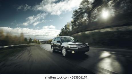 Khvalynsk, Russia - November 04, 2015: Black car Subaru Forester fast drive on asphalt road at daytime