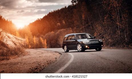 Khvalynsk, Russia - November 04, 2015: Black car Subaru Forester standing on asphalt road at sunset