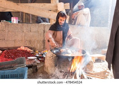 Khyber Agency, PAKISTAN - AUG 09: man making a pic of meat on local big fry pan in Tirah Khyber Agency, on 09 AUG, 2015 Khyber Agency.