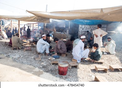Khyber Agency, PAKISTAN - AUG 09:Peoples eating frash meats with his kid and Friends in Tirah Khyber Agency, on 09 AUG, 2015 Khyber Agency.