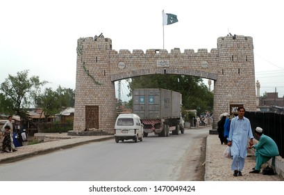 Khyber Pass, Peshawar, Khyber Pakhtunkhwa / Pakistan - Aug 16 2005: Monument on the road to the Khyber Pass in Peshawar, Pakistan. This gate is the start of the pass. Khyber Pass, Peshawar, Pakistan.