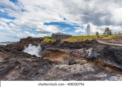 Kiama Lighthouse with water spraying out of the blowhole, Sydney, NSW, Australia