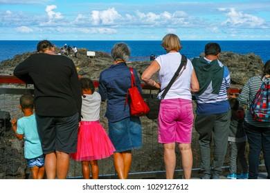 KIAMA, NEW SOUTH WALES, AUSTRALIA, FEBRUARY 4, 2017: Tourists at Kiama blowhole on Blowhole Point.