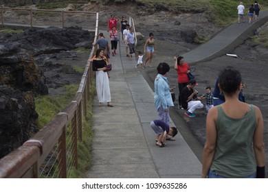 KIAMA, NEW SOUTH WALES, AUSTRALIA, JANUARY 13, 2018: Tourists at Kiama blowhole on Blowhole Point.