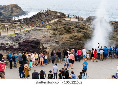 Kiama, NSW, Australia-March 31, 2018: Tourists visiting Kiama Blowhole, one of the largest blowholes in the world, a sea-cliff cavern that spouts seawater high in the air, South Coast, NSW, Australia