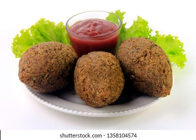 kibbeh on the plate, traditional Lebanese cuisine food, isolated on white background. Fried Burghul and meat balls