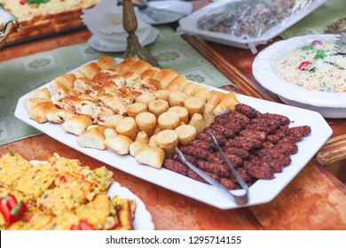 Kibe Cru Fried meat balls  table with food bread sausage