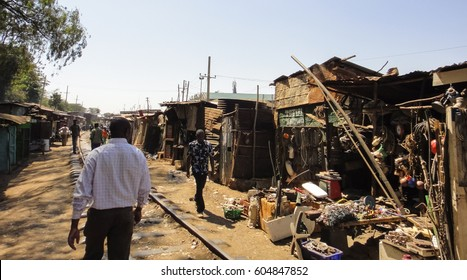 KIBERA SLUM/KENYA - SEPTEMBER 16 2013: Street along the railway in Kibera. Dwellings in Kibera slum. The largest urban slum in Africa near Nairobi City