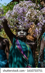 Kibish, Ethiopia - 01/01/2014. Boy from Surmi tribe, with painted face and natural decorations of leave. Surmi are also called Suri or Surma.