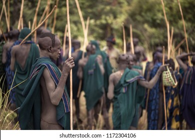 KIBISH, ETHIOPIA - AUGUST 22, 2018: unidentified men from Surmi tribe at Donga ceremony. Donga is a stick fighting where young men fight to prove their strenght and bravery