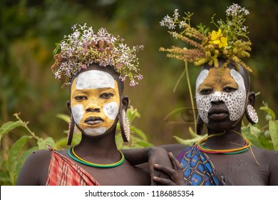 KIBISH, ETHIOPIA - AUGUST 22, 2018: unidentified women from Surmi tribe, with flower decorations. Surmi are also called Suri or Surma and live in villages in the south wester part of Ethiopia