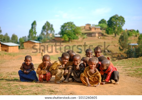 Kibuye/Rwanda - 08/25/2016: Group of african pygmy tribe children smiling and posing in ethnic village