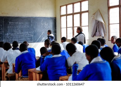 Kibuye/Rwanda - 08/26/2016: Teacher and pupils at mathematics lesson in a classroom in a school in Africa